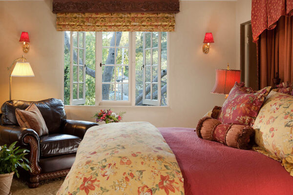 romantic suite with bed and large leather chair