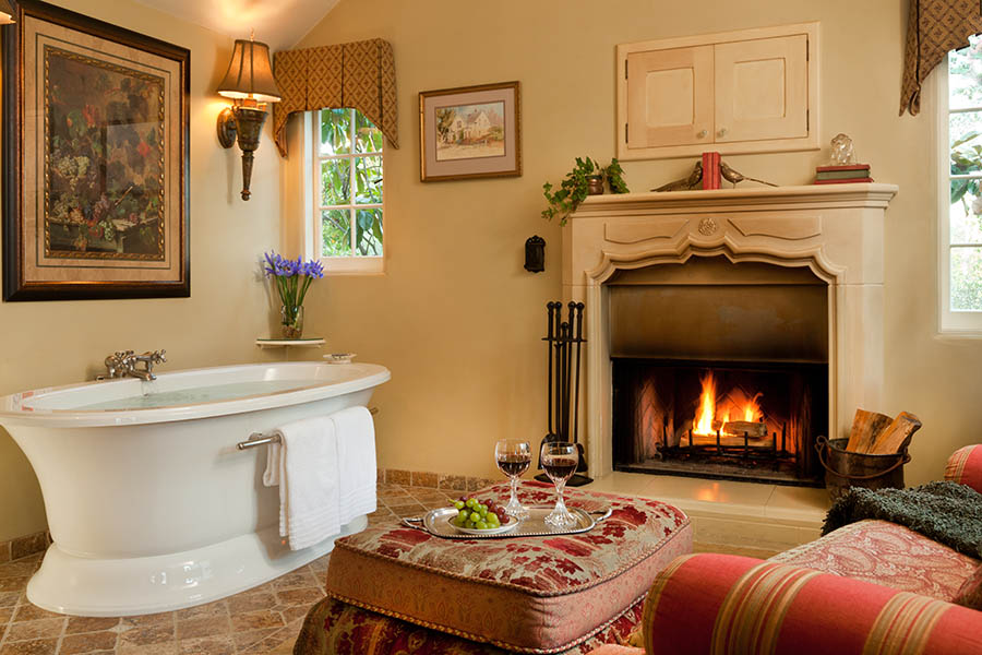 romantic suite with tub near fireplace