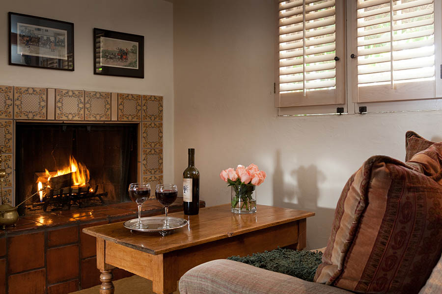 dovecote room with sitting area and fireplace