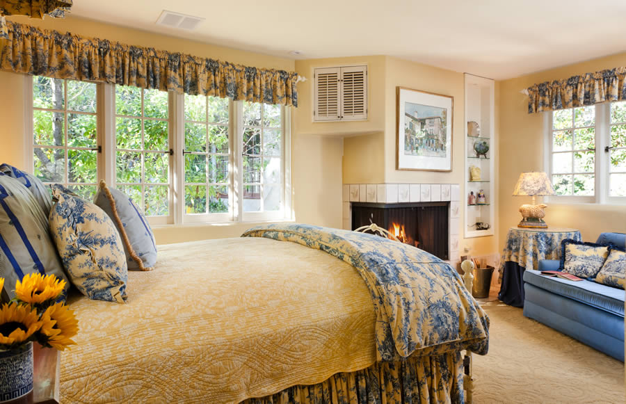 tattershall room with bed and fireplace