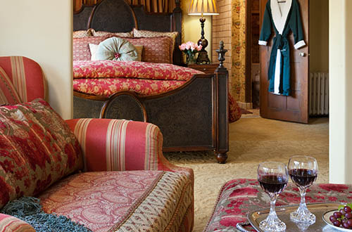 luxury suite at our monterey inn with bed and chair