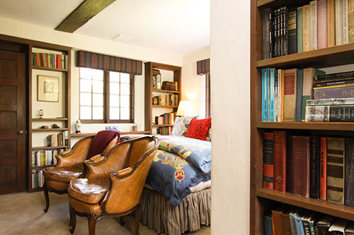 library room at monterey inn with bed and chairs