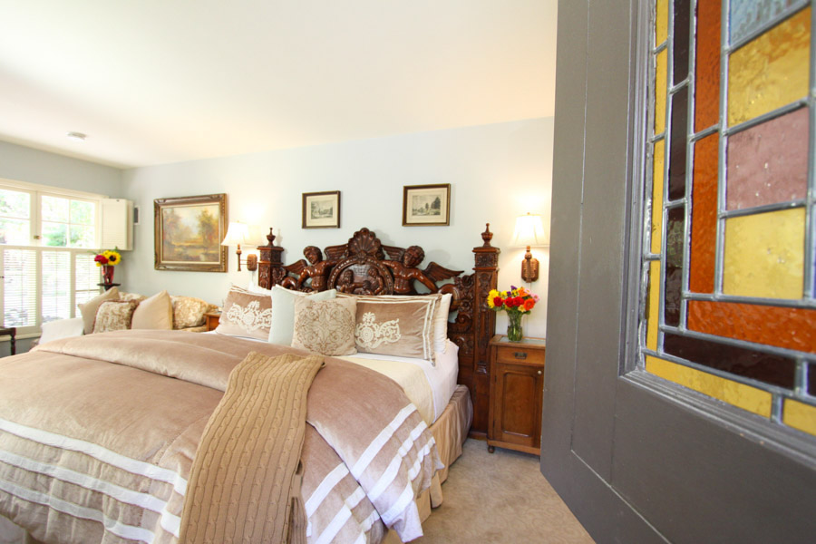 stoneleigh suite with king bed and shutter windows