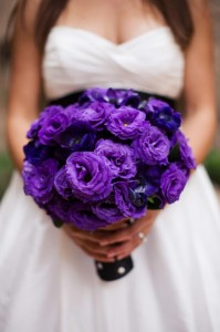 A bride with a purple bouquet