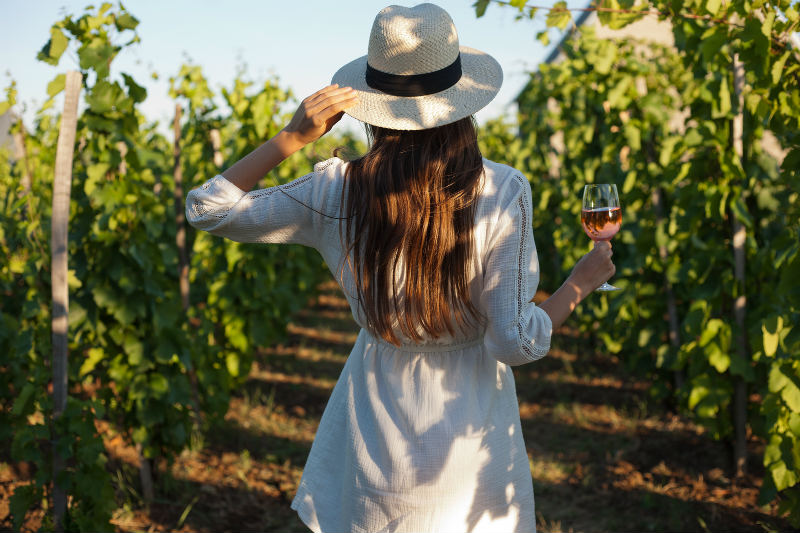 Woman standing in a vineyard at a top Monterey winery
