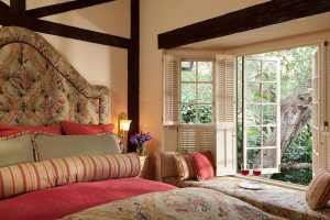 old monterey inn garden cottage with bed and window seat